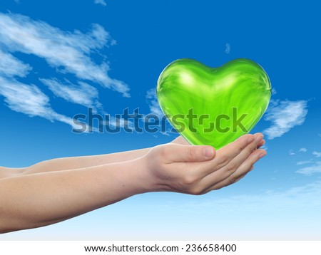 Concept or conceptual 3D green abstract heart sign  held in hands by woman or child over nice blue cloud sky background, metaphor to love, holiday, wedding, care, valentine, protection romantic - stock photo