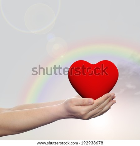 Concept or conceptual 3D red heart sign or symbol held in hands by a woman or child over nice rainbow sky background, metaphor to love, holiday, wedding, care, valentine, protection or romantic