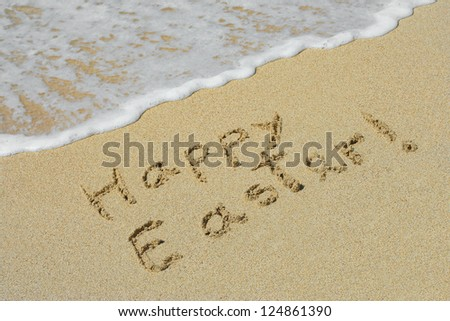 Concept or conceptual hand made or handwritten text in sand on a beach in an exotic island as metaphor to holiday,Easter,happy,greeting,spring,celebration,travel,vacation,season,tropical or tradition