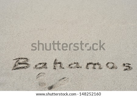 Concept or conceptual hand or handwritten Bahamas text in sand on beach in exotic island as metaphor to summer,ocean,sea,travel,vacation,tourism,tropical,coast,message,resort,paradise,sunny or water - stock photo