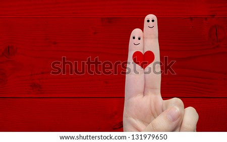 Concept or conceptual human or female hands with two fingers painted with a red heart over a old vintage wood background for valentine,romantic,love,couple,young,family or wedding - stock photo