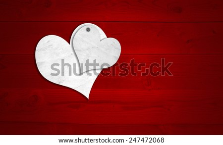 Concept or conceptual two white old paper vintage hearts nailed on red wood or wooden background, metaphor to valentine, romantic, romance, holiday, celebration, gift, card, passion, wedding message - stock photo