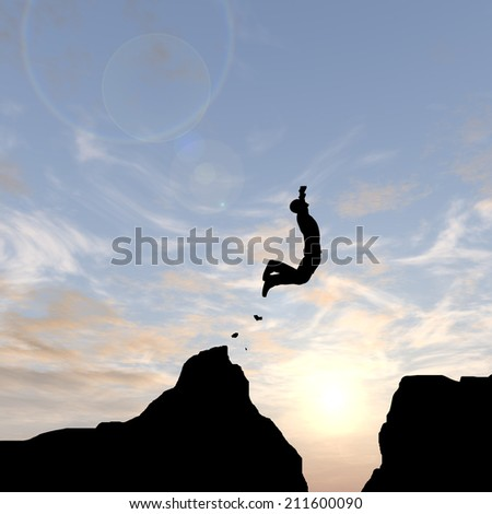 Concept or conceptual young man or businessman silhouette jump happy from cliff over  gap sunset or sunrise sky background as metaphor to freedom, nature, mountain, success, free, joy, health or risk - stock photo