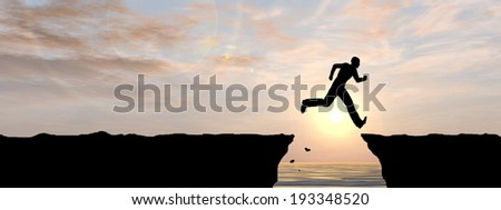 Concept or conceptual young man or businessman silhouette jump happy from cliff over water gap sunset or sunrise sky background banner - stock photo