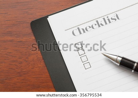 Concept : pen on book with checklist word,checklist box,wood background - stock photo