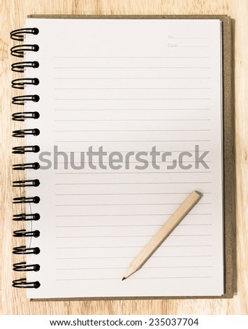 Concept pencil on blank notebook. - stock photo