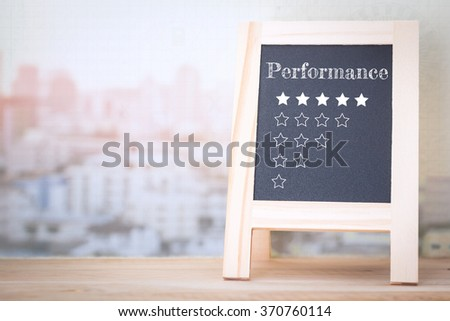 Concept Performance message on wood boards - stock photo