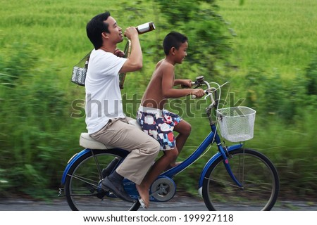 "concept photo ""drink no drive"".children(ratchanon,10 year old) riding a bicycle for drunker. - stock photo"