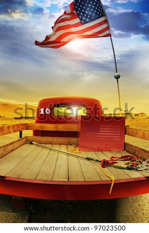 Concept photo of a vintage red vintage pick up truck with American flag waving above against rural dramatic cloudscape - stock photo