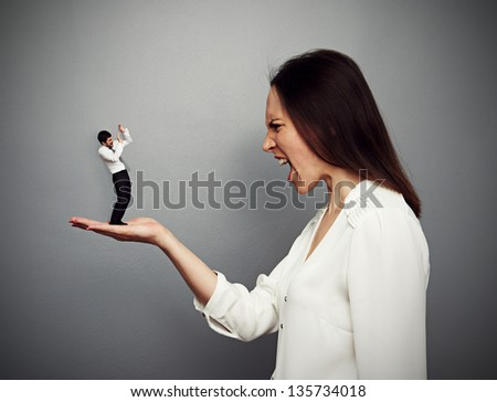 concept photo of big boss screaming at the small subordinate - stock photo