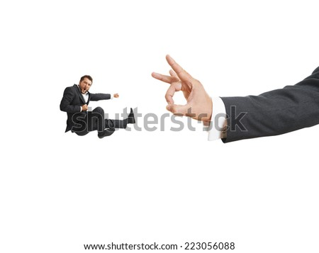 concept photo of conflict between subordinate and boss. angry screaming businessman kicking and flying at big flick of his boss. isolated on white background - stock photo