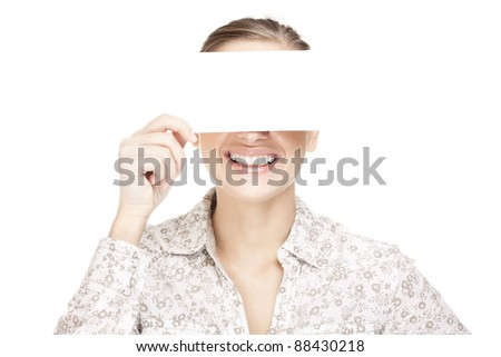 Concept photo of smiling woman holding a white card, covering her eyes - stock photo