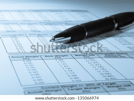 Concept photo showing a pen and financial numbers on a printout - stock photo