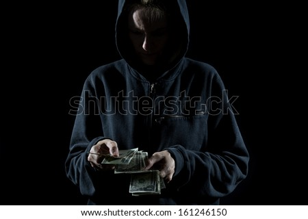 Concept photo showing a thief counting the money - stock photo