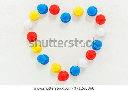 Concept, pins on  paper white the heart symbol. - stock photo