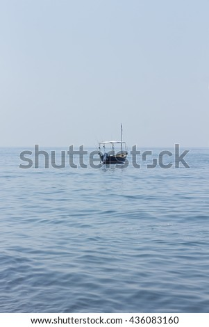 Concept: privacy. Lonely boat on the surface of the sea solitude, silence, Shallow depth of field, motion blur, blur - stock photo