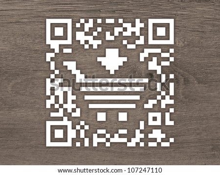 Concept QR code label with a shopping cart on a wooden background - stock photo