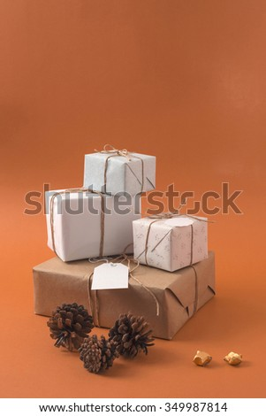 Concept retro gift boxes pile with hipster style decoration and copy space. Ideal for christmas, business sale, birthday or campaign. - stock photo