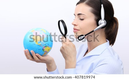 concept search, customer service operator woman with headset, globe and magnifying glass - stock photo