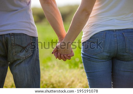 Concept shoot of friendship and love of man and woman: two hands
