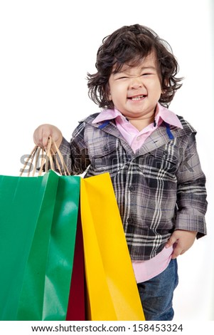 Concept shopping - Happy young child holding a bag, isolated on white. - stock photo