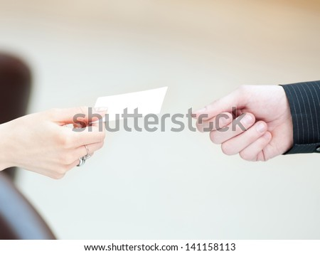 Concept shot of exchange business card between man and  woman. Partnership