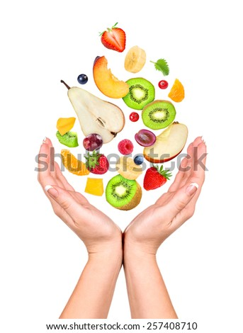 Concept: slim figure in your hands. Different fruits and berries fall in the opening  hands - stock photo