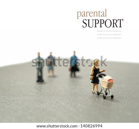Concept stock image depicting single parent with support mechanisms and assistance. Differential focus. Copy space. - stock photo