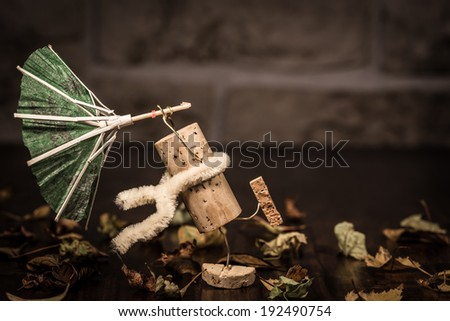 Concept stormy weather, wine cork figures - stock photo