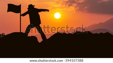 concept success,man success use hand pointing forward sunset background