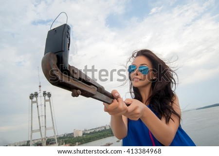 Concept: The beautiful sexy brunette girl doing selfie old vintage phone - stock photo