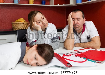 concept tired nursing staff suffering from burnout - stock photo