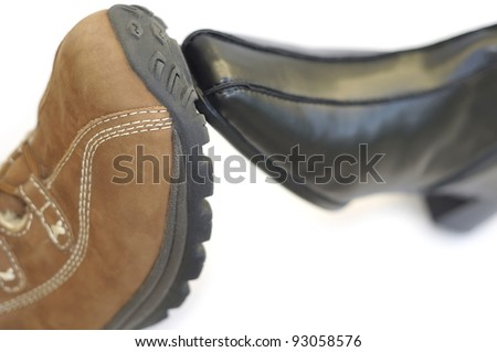Concept to illustrate a union/partnership using a male boot with a female shoe. Very short depth of field.