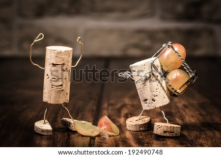 Concept Trouble between boss and employee, wine cork figures - stock photo
