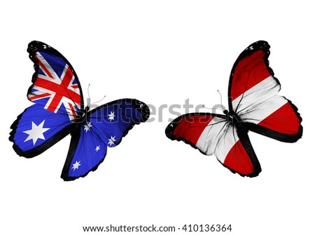 Concept - two butterflies with Australia and Austria flags flying