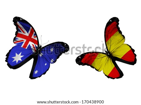 Concept - two butterflies with Australia and Spain flags flying, like two football teams playing - stock photo