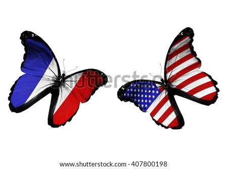 Concept - two butterflies with France and Zimbabwe flags flying - stock photo