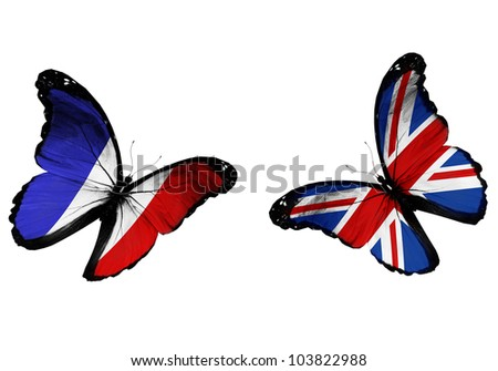 Concept - two butterflies with French and English flags flying, like two football teams playing - stock photo
