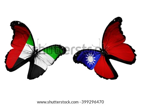 Concept - two butterflies with UAE and Taiwan flags flying - stock photo