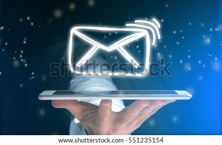 Concept view of sending message with tablet with email icon around