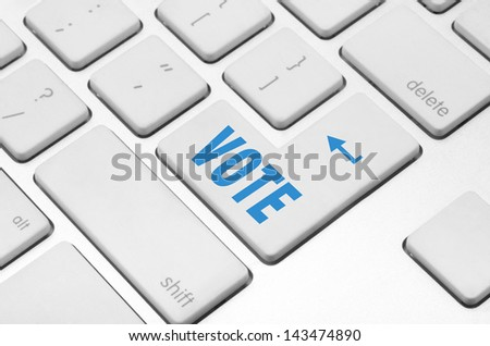 concept: Vote key on the computer keyboard - stock photo