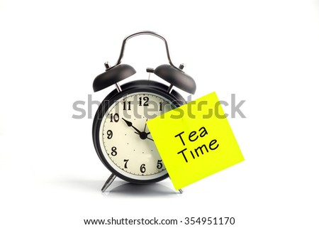 concept with alarm clock and yellow adhesive note - stock photo