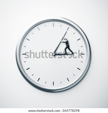 Concept with businessman trying to stop time - stock photo