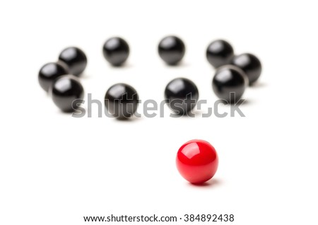 Concept with red and black marbles -  Outsider