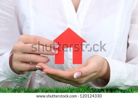 concept: woman hands with paper house, close up