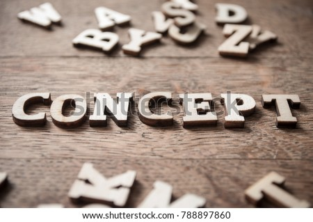 concept wooden word on wooden table background - Concept