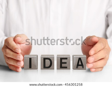 concept word forming a metal box in the open hand - stock photo