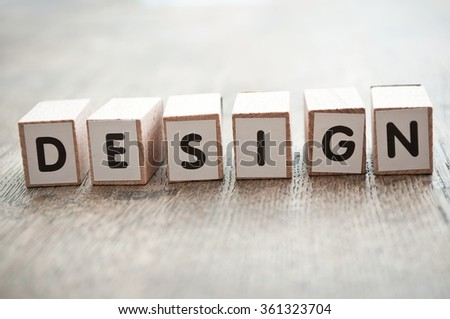 concept word forming with  cube on wooden desk background - Design - stock photo