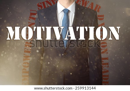 Conception of the business presented against the war background as the symbol of the continuous fight in the business. Businessman standing in dust - in the foreground is big inscription - Motivation - stock photo