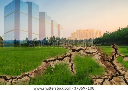 Concepts ,Drought areas from field of green cracked  of  land into the city. - stock photo